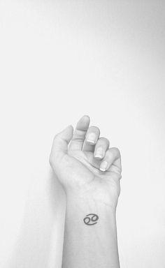 cancer zodiac sign tattoo on wrist