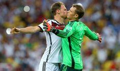 Whilst Benedikt Hoewedes and Manuel Neuer celebrate in a weird way.
