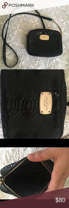 Michael Kors Cross Body Used Michael Kors Cross Body. Has some wear to it, MK symbol is scratched. Little wear on the bottom mainly used to go out with. MICHAEL Michael Kors Bags Crossbody Bags
