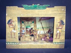 Vintage Very Rare and Unique Artistic Animated Opera Stage Model Set.    Opera lovers are in for a rare treat. This is a beautiful, artistically crafted wooden model of a set for Act II of AIDA performed at the Metropolitan Opera in N.Y.C. in the 1970s.    When a crank on the side of the model is turned the small wood carved figurines all move one way or another. It is a very intricate construction. The characters, in authentic costumes, represent Aida, Radames, Amonasro, Ramfis and the King…