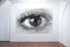 Artist Michael Murphy suspended 1,252 wooden balls that form a giant eye when they're viewed from the right angle. #illusion #art