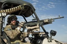 A U.S special forces member maintains security in a village during a presence patrol in Farah province, Afghanistan, Dec. 9, 2012.