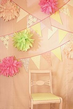 Make these cute flags and pom poms to hang in the trees and be a part of the photo booth