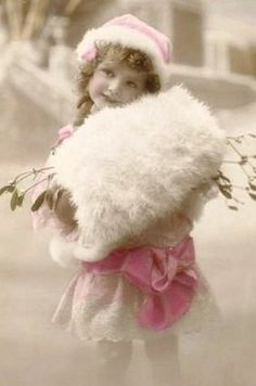Vintage child girl photo with pink dress and white fur muff