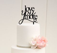 Hey, I found this really awesome Etsy listing at https://www.etsy.com/listing/165722784/love-you-more-wedding-cake-topper-custom