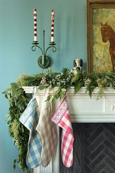 via pepperment-bliss-fireplace-mantel christmas-stockings-mantel | love the blue walls and the greens - fabulous mantel by Bailey Quinn