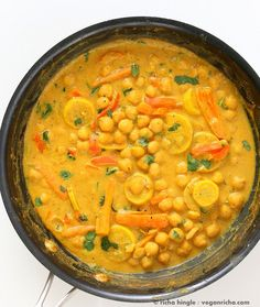Chickpeas in Turmeric Peanut Butter Curry. Easy Nut Butter Curry Sauce with Summer veggies and Chickpeas. Vegan Gluten-free Soyfree Recipe | VeganRicha.com