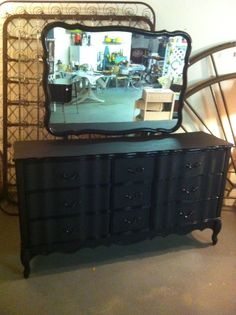 Dresser My boyfriend just finished painting.  Used matte and gloss black paint.  A little Pinterest project.