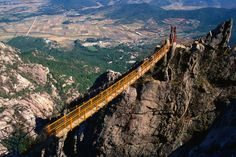 Steel stairways, South Korea  Slung with steel stairways and suspension bridges, Wolchulsan makes for spectacular day hikes.