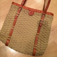 Used only twice! No marks/stains. GREAT condition Tote basket (straw) over the shoulder bag. Standard size with genuine leather. Purchased at the IL BISONTE store in New York a few years ago. Looks brand new...great to pair with any outfit! IL BISONTE  Bags Shoulder Bags