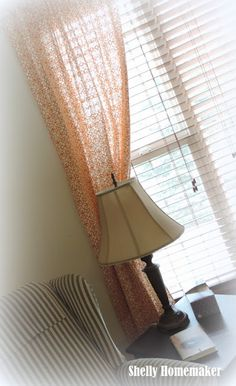 Love the orange curtains!  Need a plan for that lamp share!