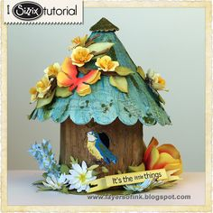 Sizzix Die Cutting Tutorial: Susans Garden Birdhouse by Anna-Karin Evaldsson, made with Susan's Garden dies by Susan Tierney-Cockburn. All the flowers were made from white paper coloured with Distress Inks. Lots of techniques. Tutorial: http://sizzixblog.blogspot.com/2013/05/susans-garden-birdhouse-and-flowers.html