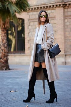 beige coat and thigh high boots