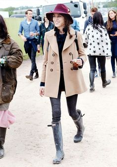 Alexa Chung in a classic khaki trench and Hunter wellies at #Glastonbury 2013 // #CelebrityStyle