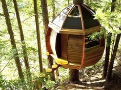 This treehouse designed by Joel Allen is called the HemLoft. It was constructed out of recycled materials. It wraps around a single tree in the backwoods in Whistler, British Columbia.
