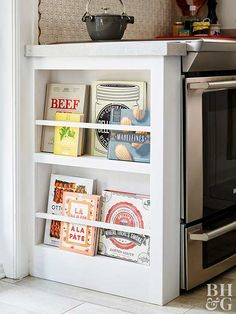 Storage space can come from unexpected places. Often-neglected areas, like cabinet sides, can provide some seriously helpful solutions. Install a narrow shelf with a dowel rod to hold cookbooks and magazines next to your island or cooking station. Cuisines Diy, Cuisines Design, New Kitchen Cabinets, Kitchen Redo, Narrow Kitchen, Kitchen Shelves, Island Kitchen, Kitchen Sinks, Cookbook Storage