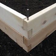Corner pin construction for raised beds.  Secure the board, or use a longer pin to secure the bed to the ground!