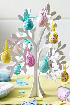 For a stunning table centrepiece, pick up our wooden Easter tree and decorate with these cute painted Easter egg decorations. Available in store and online.
