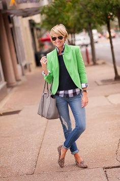 Shop this look for $228:  http://lookastic.com/women/looks/crew-neck-sweater-and-blazer-and-button-down-shirt-and-tote-bag-and-skinny-jeans-and-ballerina-shoes/3965  — Black Crew-neck Sweater  — Green Blazer  — Grey Plaid Button Down Shirt  — Grey Leather Tote Bag  — Blue Ripped Skinny Jeans  — Brown Leopard Suede Ballerina Shoes
