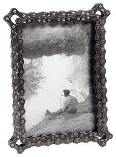 Bike Chain Frame - $36.00»  Put a new spin on framing pictures with this chain frame. It's a great way to frame pictures from a recent bike trip or adventure along the back-road trails.