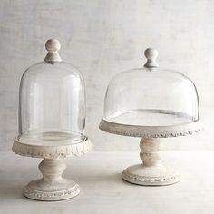 Handcrafted of mango wood with intricate carved details, our whitewashed cake stands will beautifully display your desserts. With glass domes and wooden knobs, they strike farmhouse-style poses with ease.