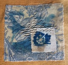 Cyanatype print on vintage fabric and hand stitching. Ann Stephens