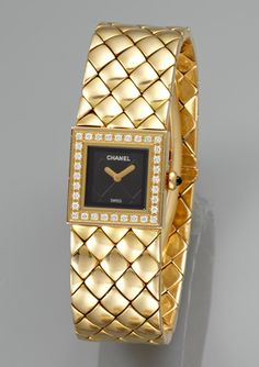 Chanel's Black Onyx Quilted Dial w/ 32 Bezel-Set Diamond Surround & Quilted 18K Gold Bracelet Water-Resistant Ladies Watch
