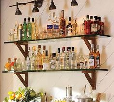 Glass shelves with rustic wood brackets for master bath