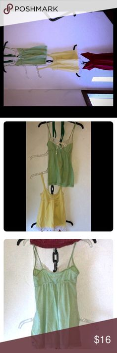 3 Hollister XS pretty playful babydoll Tanks EUC 1.  M&M Green and white striped baby doll top White eyelet detail and key hole with tie on top EUC 2. Pastel yellow baby doll top EUC  Pretty white eyelet trim along the bottom hem 2 White button details & cinched chest area 3. Red & White baby doll top SOME FADING This is my favorite of the three because it has the most detail. I love the pretty Red and white polkadot belt that ties into a bow in the back - this same polkadot detail…