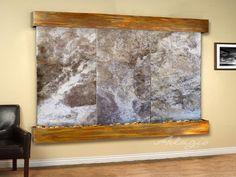 Adagio Solitude River Wall Fountain. Indoor wall mounted water fountain Sheet Rock Walls, Indoor Wall Fountains, River Pebbles, Metal Trim, Travertine, Metallic Paint, Solitude, Wall Mount, Bulb