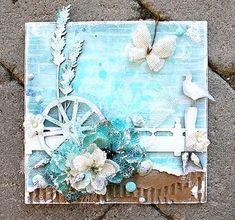 Summer inspiration Card from Helena Johansson.  The Burlap flowers and butterflies from Petaloo mixed with the aqua blue paper and accessories...just makes you dream of the beach!  See it on the Petaloo Blog!