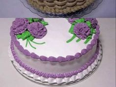 Lots of nice cake designs.  Many have ruffle border on the bottom with a shell border directly above it.