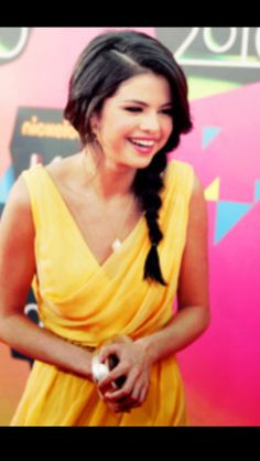 Selena laughing and looking gorgeous with her side braid!!! :)