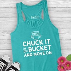 Chuck it in the fuckit bucket ladies tank top. Welcome to the Snark Tank. We all need a little sparkle and snark. Now you can wear your cheeky sarcasm or show off your well-earned wit and wisdom on our soft vintage tees. #suzyswede Funny t-shirts, clever sayings, a touch of sarcasm, and lots of good vibes. #funnyshirt #relatable #graphictees #workoutshirts #funnytshirts #sarcastictshirts #over40 #introvertshirts #funnyshirt #funnygifts