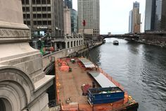 Workers were spotted unloading giant panes of curved glass from barges this week.
