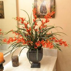 """Silk Flower Arrangment - Red Oncidium Orchids AR310. Orchids and grasses! This is a stunning presentation, very natural looking in a lovely dark resin vase. 27""""H X 22""""W:"""