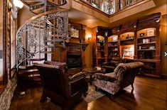 2-story Study with iron spiral staircase to Library Loft