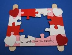 Using old puzzles pieces, paint them red, white, and pink. Glue them onto Popsicle sticks. A cute homemade picture fram