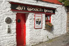 Old Pubs in Ireland - Whitewashed old Irish pub with red roof & Guinness beer sign, An Teach Beas (Gaelic for The Small House) in southwest Ireland Ireland Pubs, County Cork Ireland, Ireland Travel, Guinness, Erin Ireland, Old Irish, West Cork, Old Pub, Irish Cottage