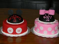 Mickey and Minnie Mouse Cakes for Twins - I did these cakes for two year old twins. Mickey is chocolate and Minnie is vanilla. The hats are RKT covered in fondant.