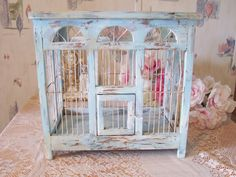 Antique Bird Cage Terrarium, Distressed French Blue Display Case, Magazine Rack, Wedding Card Box, Curio, Farmhouse, Chippy Blue Terrarium Cabinet. This wire and wood antique birdcage arrived to me in great overall condition, however a dull drab brown stained wood and when I looked closely at the fine details, I could envision this sitting in the bay window of a farmhouse holding a plant vignette, much like an open air terrarium. Then I saw it had so much potential and thought it would…
