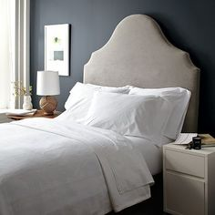 I love the Scroll Headboard on westelm.com.  Might be better for the guest room since it can be accessorized to look modern or traditional.