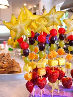 Fruit Wands!    These would be great for an every-day snack or a birthday party. They're so colorful and pretty!