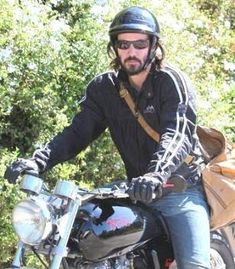 Keanu Reeves on his motorcycle in Hollywood September 23, 2009. X17online.com exclusive http://www.moviefone.com/celebrity/keanu-reeves/13...