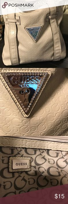 ❤️❤️GUESS TOTE BAG/CREAM GIESS TOTE BAG -  I Love this tote bag!❤️❤️.  I use a purse maybe 2 times a year so it hasn't been used much and is in good condition.  It does have a small blue ink spot and highlighter spot.  See photos.  No one is going to see he inside.😊😊Lol!  The outside is gorgeous!  Bundle 2 or more items from my closet and get 10% Off.  I will consider all offers.  Happy Poshing 😊❤️❤️ Guess Bags Totes