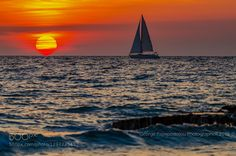 Traveling at sunset by GeorgePapapostolou
