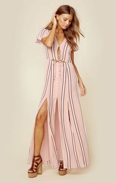 """<p class=""""product-desc-body"""">The Privacy Please Sherman Dress features front cutouts with button closure, side slits, and an easy flowy fit. </p>  </p><ul class=""""product-desc-list""""><li>Imported</li><li>Dry Clean Only</li><li>100% Rayon</li></ul><p class=""""product-desc-head"""">Fit Guide:</p><ul  class=""""product-desc-list""""><li>Model is 5ft 9 inches; Bust: 32"""", Waist: 24"""", Hips: 35""""</li><li>Model is wearing a size XS</li><li>Relaxed Fit</li><li>Shoes Featured Not Available For Purchase</li></ul>"""