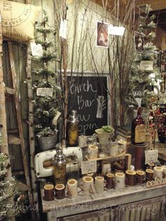 Round Barn Potting Company; use branches & fake Cmas trees for display
