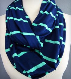 Navy Striped Infinity Scarf by K. Michael on Scoutmob Shoppe. This bold and nautical navy-striped infinity scarf is made from a cotton and jersey fabric making it irresistibly soft.