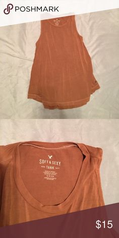 Like new American eagle soft and sexy tank Very comfy high neck American eagle soft and sexy tank in like new condition bought within the last year and only worn once. It's a light brownish color a perfect neutral for spring! I ❤️ offers! American Eagle Outfitters Tops Tank Tops